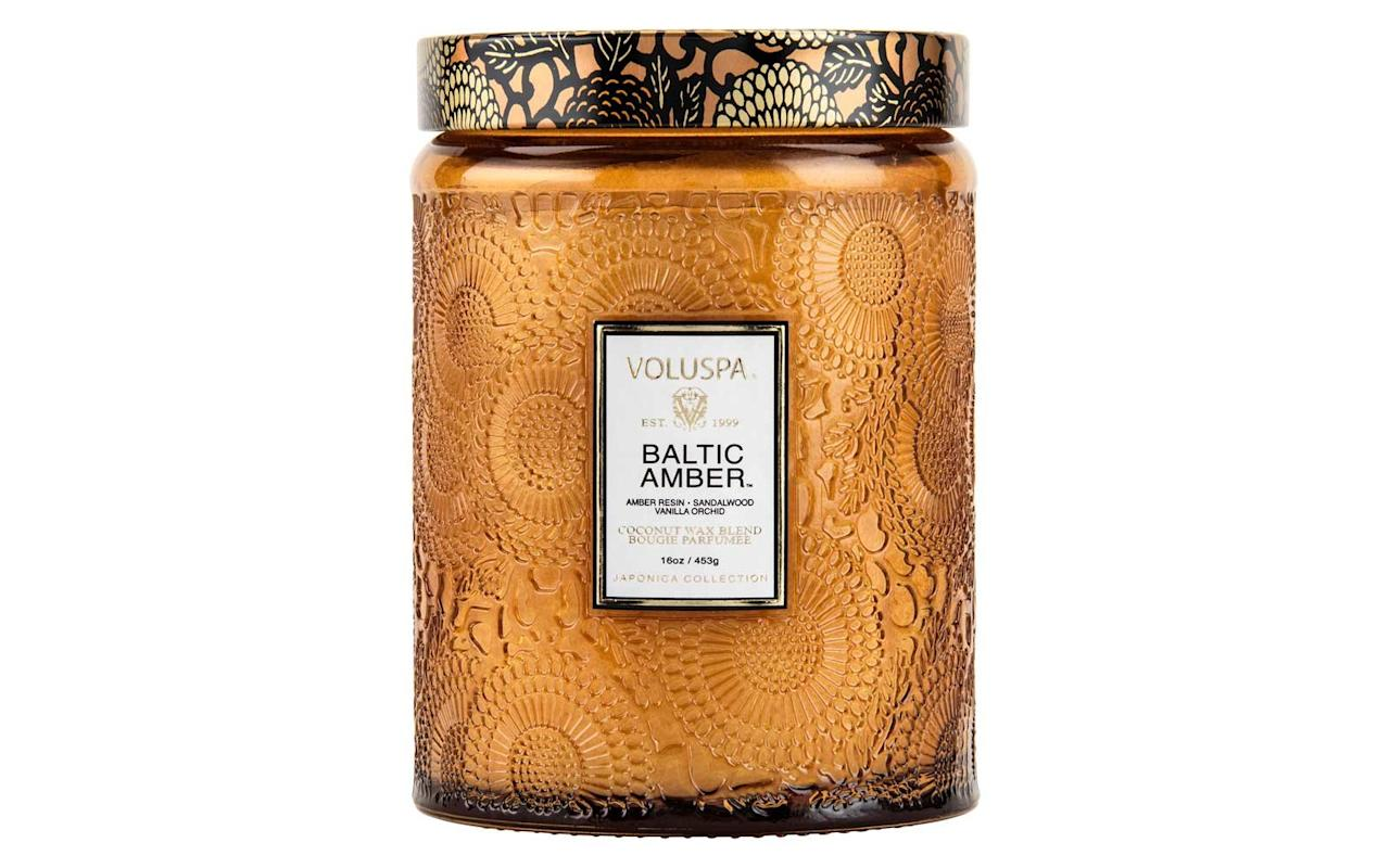 "<p>This candle's rich amber scent will make any room cozier.</p> <p>To buy: <a href=""https://click.linksynergy.com/deeplink?id=93xLBvPhAeE&mid=1237&murl=https%3A%2F%2Fshop.nordstrom.com%2Fs%2Fvoluspa-japonica-baltic-amber-large-embossed-glass-jar-candle%2F4176374%3Forigin%3Dkeywordsearch-personalizedsort%26breadcrumb%3DHome%252FAll%2520Results%26color%3Dnone&u1=TL%2C50FunGiftIdeasfor%252450orLess%2Cspearmac%2CGIF%2CGAL%2C456692%2C201911%2CI"" target=""_blank"">nordstrom.com</a>, $28</p>"