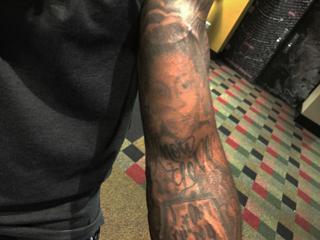 """<p>Captain Munnerlyn, defensive back, Carolina. """"It's the one of my mom. I got it when I was 18 years old. I kind of snuck and got it. My mom is a preacher, so she didn't know I had tattoos. I never had any below my elbows. I used to hide it when I was in high school. I had my initials on the back of my arm and my mom never knew—even though I played football and ran track. I'm sitting there like I know she sees them, but she never said anything to me. One day my sister told on me. I had come home from college and had just gotten some on my leg and my sister saw it and she said, """"Momma you need to tell Captain to stop getting all these tattoos."""" She said TATTOOS?! By that time I probably had 20. I had to take off my clothes and show my mom my tattoos. She saw the one of herself and said, 'Oh my God that looks just like me!' """"</p>"""