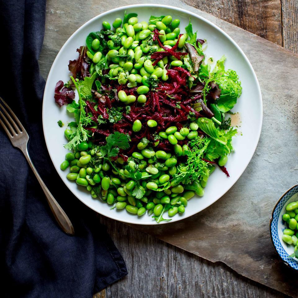 """<p>This big salad is a feast for the eyes and an everyday way to incorporate nutrient-rich beets and plant-based protein from edamame (green soybeans). If you're not a fan of cilantro, mix in freshly chopped basil or dill instead. <a href=""""http://www.eatingwell.com/recipe/259814/green-salad-with-edamame-beets/"""" rel=""""nofollow noopener"""" target=""""_blank"""" data-ylk=""""slk:View recipe"""" class=""""link rapid-noclick-resp""""> View recipe </a></p>"""