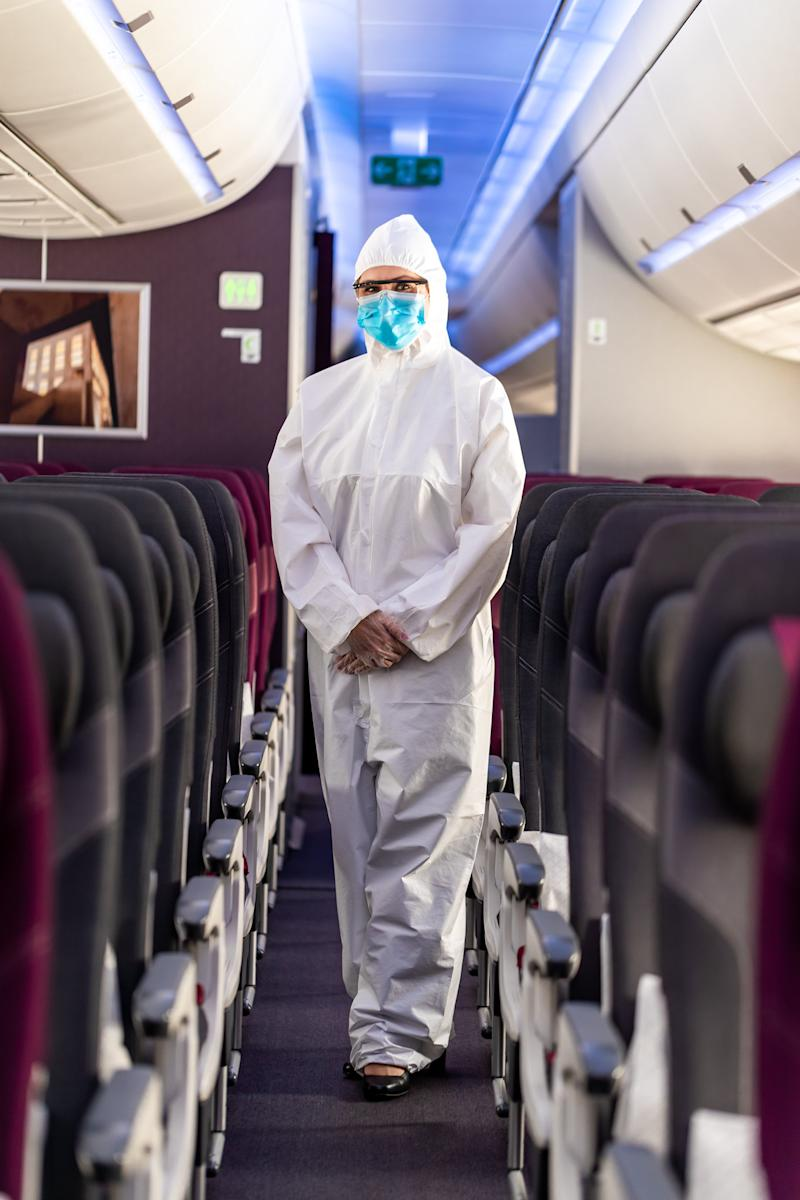 A Qatar Airways flight attendant in Personal Protective Equipment. The outfit is part of safety measures to guard against the coronavirus Covid-19 pandemic. (Photo: Qatar Airways)