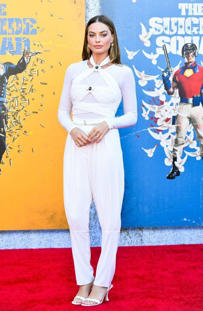 """<p>To celebrate the release of her latest film Margot Robbie stepped into a white jumpsuit from Chanel's latest Resort collection, paired with some By Far heels.</p><p><a class=""""link rapid-noclick-resp"""" href=""""https://go.redirectingat.com?id=127X1599956&url=https%3A%2F%2Fwww.farfetch.com%2Fuk%2Fshopping%2Fwomen%2Fby-far-double-strap-mules-item-16211683.aspx&sref=https%3A%2F%2Fwww.elle.com%2Fuk%2Ffashion%2Fcelebrity-style%2Fg30889%2Fmargot-robbie-best-looks-style-in-pictures%2F"""" rel=""""nofollow noopener"""" target=""""_blank"""" data-ylk=""""slk:SHOP MARGOT'S HEELS NOW"""">SHOP MARGOT'S HEELS NOW</a></p>"""