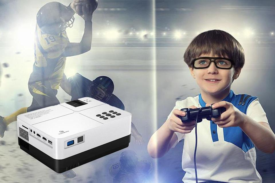a little boy with VR glasses playing a video game, transposed on an image of a football player