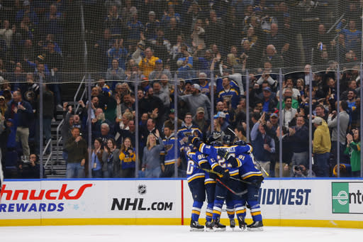 St. Louis Blues' Tyler Bozak celebrates with teammates after scoring against the Nashville Predators in the third period of an NHL hockey game Tuesday, Feb. 26, 2019, in St. Louis. (AP Photo/Dilip Vishwanat)