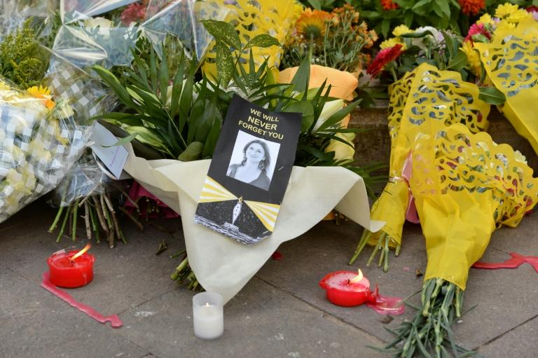 Flowers were placed at the Great Siege monument in Valletta, Malta, on Thursday as a tribute to the murdered investigative journalist Daphne Caruana Galizia and tributes lay at the foot of the Great Siege monument in Valletta, Malta on October 19, 2017 which has been turned into a temporary shrine for Maltese journalist and blogger Daphne Caruana Galizia who was killed by a car bomb outside her home in Bidnjia, Malta, on October 16, 2017