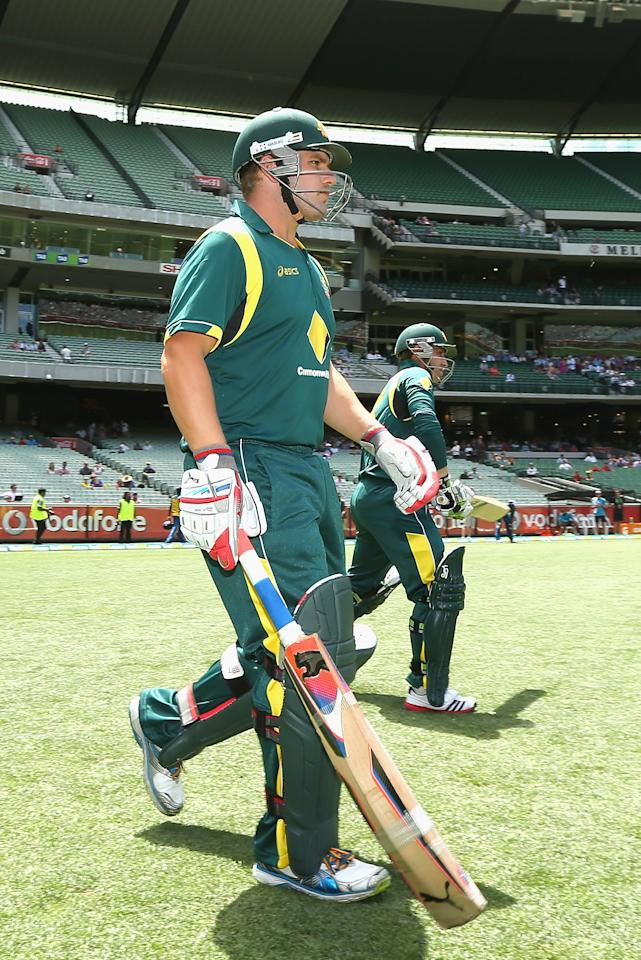 MELBOURNE, AUSTRALIA - JANUARY 11:  Aaron Finch and Phillip Hughes of Australia walk out to bat during game one of the Commonwealth Bank One Day International series between Australia and Sri Lanka at the Melbourne Cricket Ground on January 11, 2013 in Melbourne, Australia.  (Photo by Quinn Rooney/Getty Images)