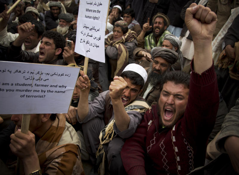 "FILE - In this Saturday, March 16, 2013 file photo Afghan men chant ""U.S. special operations forces out!"" as several hundred demonstrators marched to the Afghan parliament building in Kabul, Afghanistan. A senior U.S. commander said Saturday, March 30, 2013 that American special operations forces have handed over their base in eastern Afghanistan's Nirkh district to local Afghan commandos -- meeting a demand by Afghan President Hamid Karzai that U.S. forces withdraw from the district after allegations that their Afghan counterparts committed human rights abuses there. (AP Photo/Anja Niedringhaus, File)"