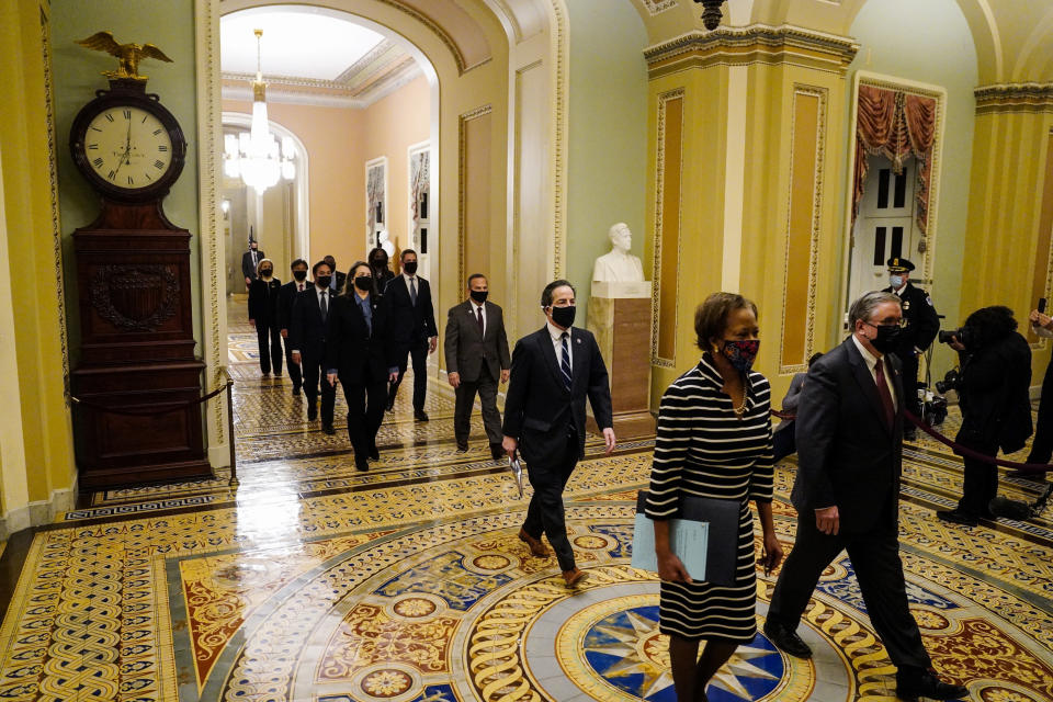Clerk of the House Cheryl Johnson along with acting House Sergeant-at-Arms Tim Blodgett lead the Democratic House impeachment managers as they walk through the Capitol Hill to deliver to the Senate the article of impeachment alleging incitement of insurrection against former President Donald Trump, in Washington, Monday, Jan. 25, 2021. (Melina Mara/The Washington Post via AP, Pool)