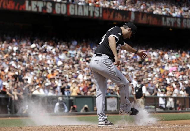 Chicago White Sox manager Robin Ventura kicks dirt over the plate after being ejected for arguing a call on San Francisco Giants' Gregor Blanco, who was originally ruled out at home but then ruled safe after review, during the seventh inning of a baseball game against the San Francisco Giants in San Francisco, Wednesday, Aug. 13, 2014. (AP Photo/Jeff Chiu)