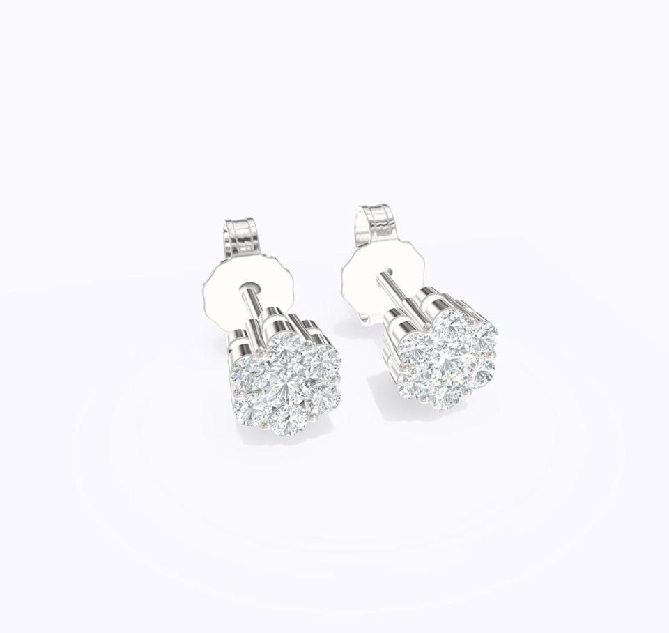 """<p><span>Verlas Floral Studs</span> ($367)</p> <p>""""I've been looking for a pair of investment earrings and these diamond Verlas studs are elegant and I can wear them every day."""" - NC </p>"""