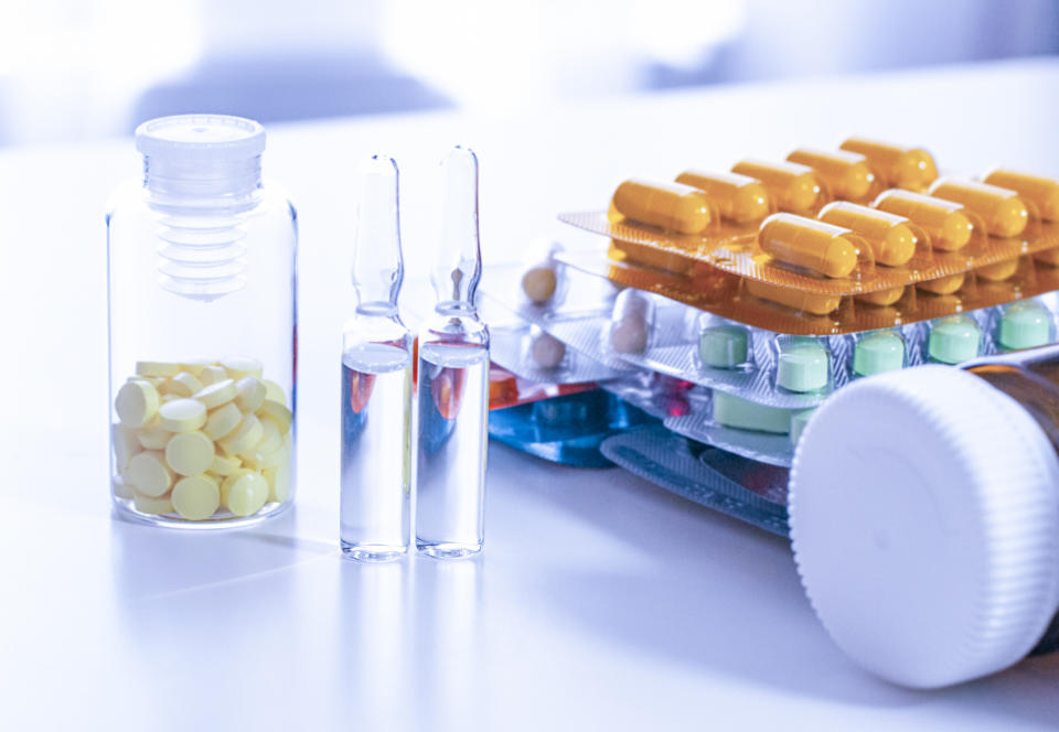 Medical ampoules, pill and bottle on the white table