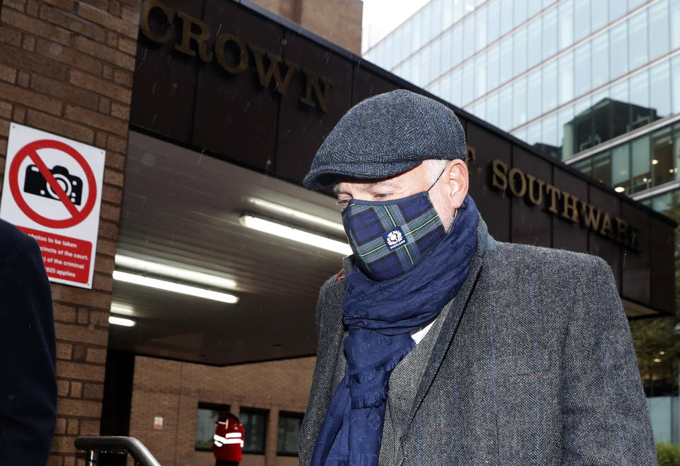 John Leslie, former children's television presenter, leaves Southwark Crown Court on the second day of his trial in London, Tuesday, Oct. 13, 2020. Leslie is accused of one count of sexual assault relating to unwanted sexual touching of a woman in 2008. (AP Photo/Alastair Grant)