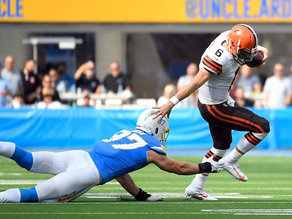 Baker Mayfield escapes a tackle against the Los Angeles Chargers.