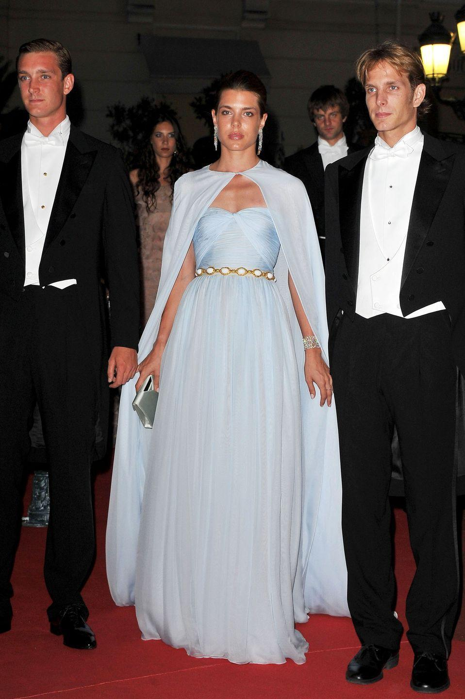 """<p>Grace Kelly's granddaughter set the fashion world abuzz in this powder blue Giambattista Valli gown and cape set. Many publications named <a href=""""https://www.townandcountrymag.com/society/tradition/g30769224/charlotte-casiraghi-photos-style/"""" rel=""""nofollow noopener"""" target=""""_blank"""" data-ylk=""""slk:Charlotte Casiraghi"""" class=""""link rapid-noclick-resp"""">Charlotte Casiraghi</a> the best-dressed guest at Prince Albert II of Monaco's 2011 wedding to Princess Charlene. The young royal has since made a name for herself in the fashion world, even becoming the face of Gucci. <br></p>"""