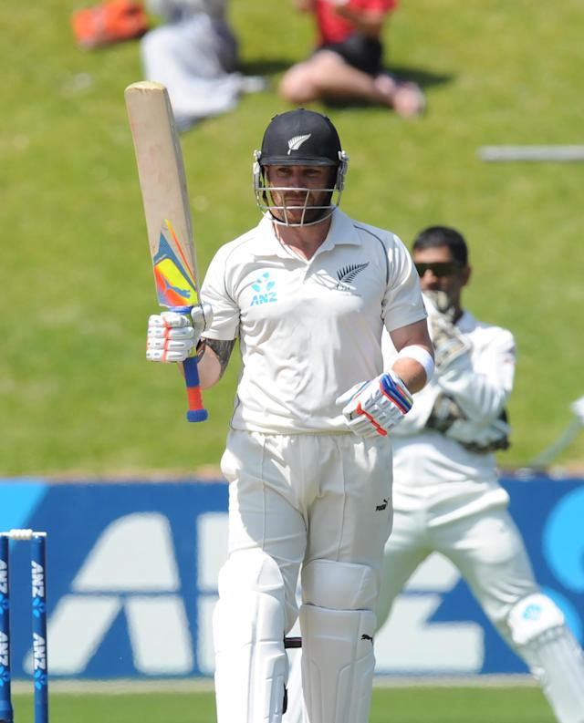 New Zealand's Brendon McCullum signals his 150 runs against India on the fourth day of the second cricket test at Basin Reserve in Wellington, New Zealand, Monday, Feb. 17, 2014. (AP Photo/SNPA, Ross Setford) NEW ZEALAND OUT