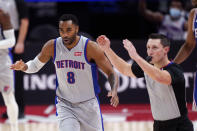 Detroit Pistons guard Wayne Ellington (8) reacts after a three-point basket during the first half of an NBA basketball game, Monday, Jan. 25, 2021, in Detroit. (AP Photo/Carlos Osorio)