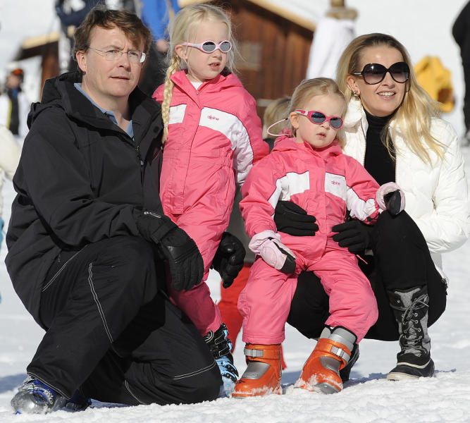 """FILE - In this Feb. 19, 2011 file photo Netherland's Prince Friso, left, and his wife Princess Mabel, right, pose with their daughters Luana and Zaria for photographers during a photo session in the Austrian skiing resort of Lech. The Dutch royal house says in a statement on Monday, Aug. 12, 2013 that Prince Johan Friso, the youngest brother of King Willem-Alexander, has died of complications after the 2012 skiing accident that left him with grave brain damage. In a statement, the royal house said that the 44-year-old Friso had never regained more than """"minimal consciousness"""" after the accident, in which he was buried by an avalanche. He died Monday at the Palace Huis ten Bosch, in The Hague, Netherlands, where he was being cared for. (AP Photo/Kerstin Joensson, File)"""