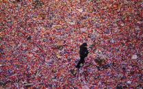 A policeman walks through confetti after it was dropped on revelers at midnight during New Year's Eve celebrations in Times Square in New York January 1, 2014. REUTERS/Gary Hershorn