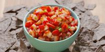 """<p>It's hard to believe that this <a href=""""https://www.delish.com/uk/cooking/a32570797/easy-homemade-salsa-recipe/"""" rel=""""nofollow noopener"""" target=""""_blank"""" data-ylk=""""slk:salsa"""" class=""""link rapid-noclick-resp"""">salsa</a> would be good, but trust us—it's amazing. Use it exactly how you would a tomato-based salsa: with tortilla crisps, as a condiment on fish, or, frankly, with a spoon.</p><p>Get the <a href=""""https://www.delish.com/uk/cooking/recipes/a33059691/strawberry-salsa-recipe/"""" rel=""""nofollow noopener"""" target=""""_blank"""" data-ylk=""""slk:Strawberry Salsa"""" class=""""link rapid-noclick-resp"""">Strawberry Salsa</a> recipe.</p>"""