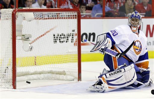 New York Islanders goalie Evgeni Nabokov (20), from Kazakhstan, looks back at the goal by Washington Capitals center Mike Ribeiro during the second period of an NHL hockey game Tuesday, March 26, 2013 in Washington. (AP Photo/Alex Brandon)