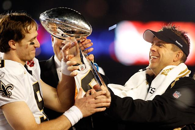 Drew Brees and head coach Sean Payton show off the spoils of victory after defeating the Colts – led by Peyton Manning – in Super Bowl XLIV in 2010. (Getty Images)