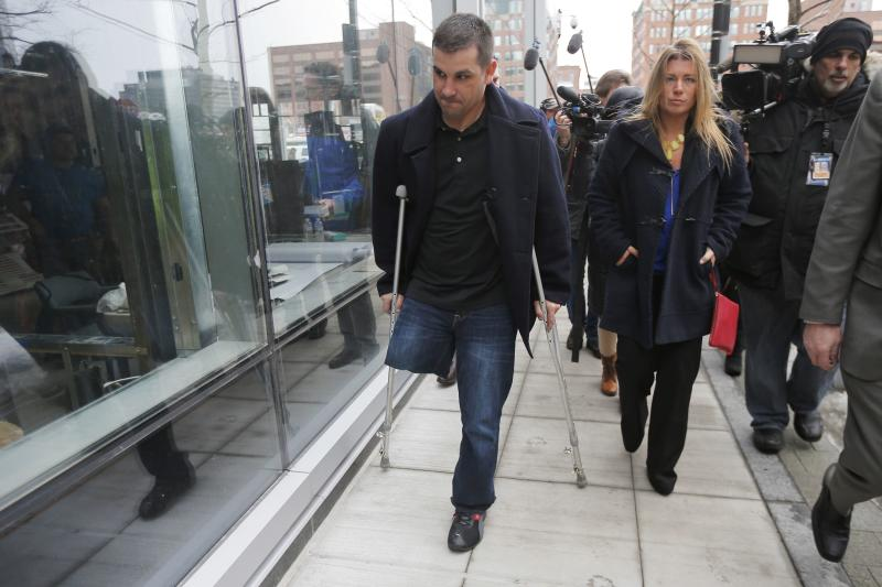 Boston Marathon bombing survivor Marc Fucarile (L) leaves the federal courthouse on the first day of the trial of accused bomber Dzhokhar Tsarnaev in Boston, Massachusetts March 4, 2015.      REUTERS/Brian Snyder    (UNITED STATES - Tags: CRIME LAW)