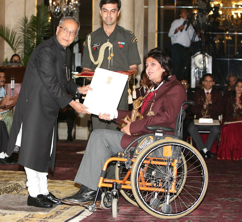 Then-President Pranab Mukherjee honours  Paralympian athelete Deepa Malik with Arjuna Award 2012 with Arjuna Award 2012 at President's House in New Delhi on Wednesday, 29 August, 2012 . (Photo by Naveen Jora/The India Today Group via Getty Images)