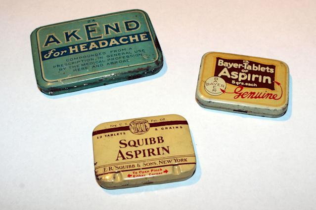 <p>Aspirin tins: Squibb, found in the south side of the first floor airshaft in 1993; Bayer tablets, found under the floorboards in the kitchen of what is the recreated Moore Apartment on the fourth floor in 2008, and Akend, found under the floorboards in the kitchen of Apartment 3 on the second floor of 97 near the sink in 1993. (Photo: Caters News) </p>