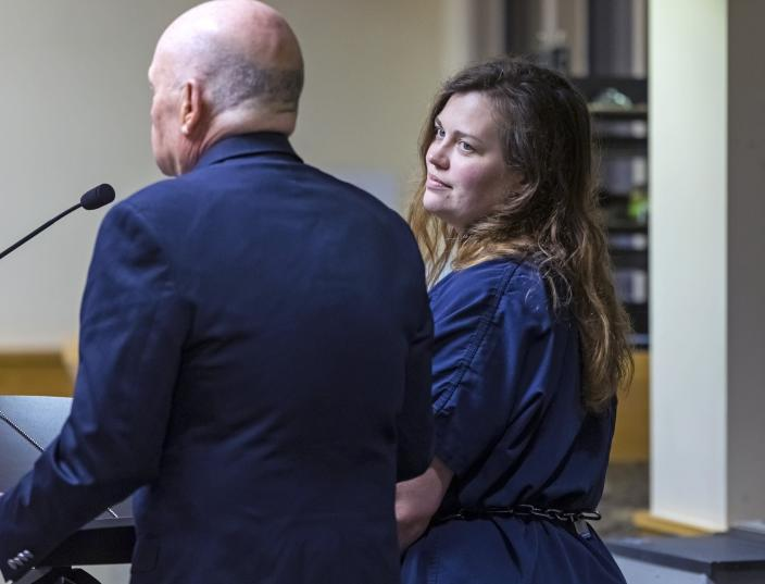 Hannah Roemhild, right, who is accused of driving through checkpoints outside President Donald Trump's Florida home Mar-a-Lago, listens during her initial appearance hearing, Monday, Feb. 3, 2020, West Palm Beach, Fla. (Lannis Waters/The Palm Beach Post via AP)