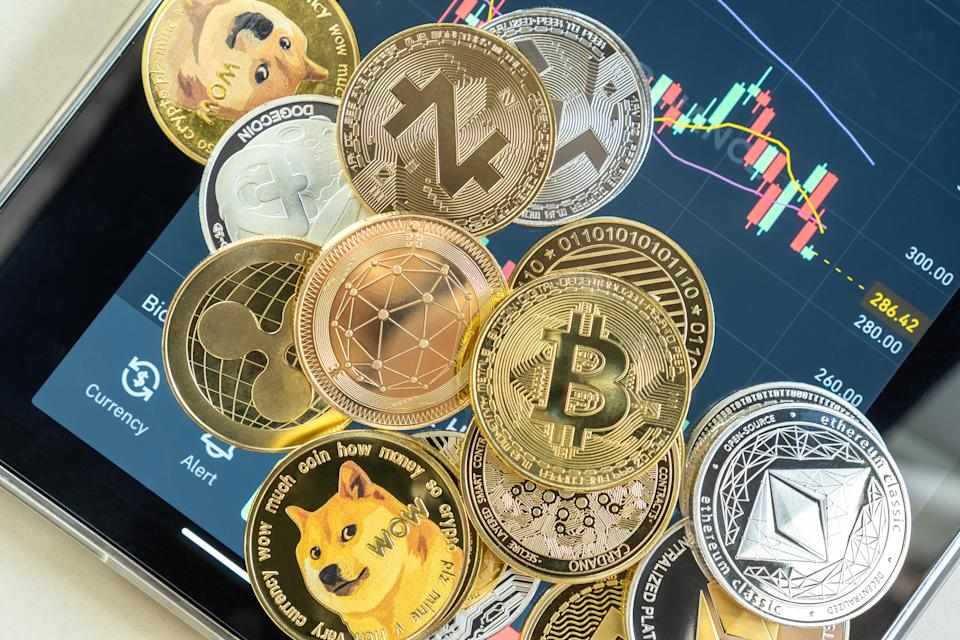 Bangkok, Thailand - 1 July 2021: Cryptocurrency on Binance trading app, Bitcoin BTC with altcoin digital coin crypto currency, BNB, Ethereum, Dogecoin, Cardano, defi p2p decentralized fintech market