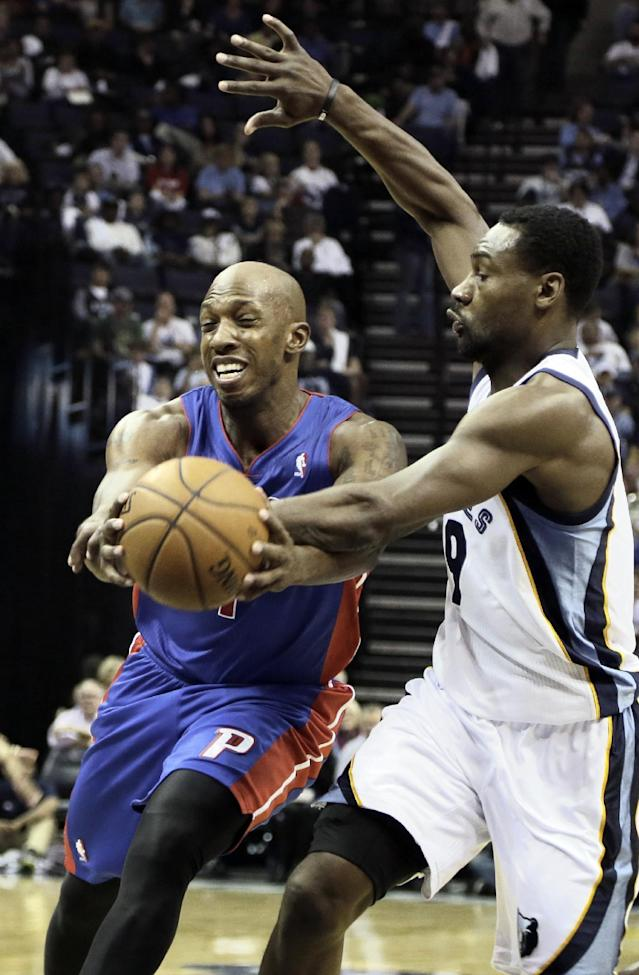 Detroit Pistons' Chauncey Billups, left, moves the ball in front of Memphis Grizzlies' Tony Allen (9) in the first half of an NBA basketball game in Memphis, Tenn., Friday, Nov. 1, 2013. (AP Photo/Danny Johnston)
