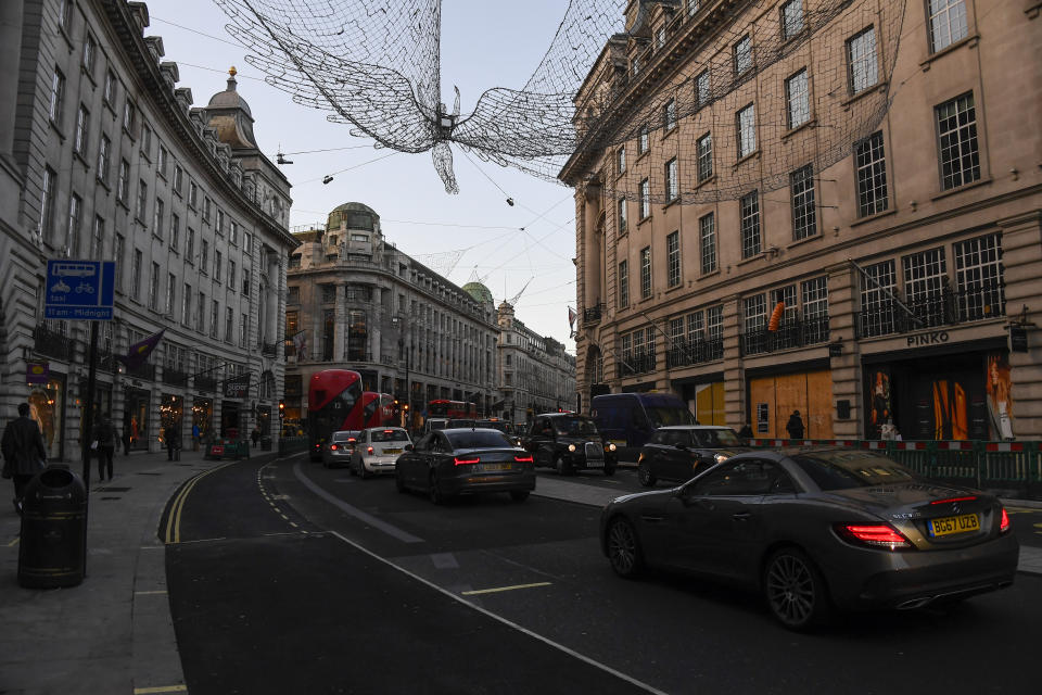 Traffic in Regent Street, London, Wednesday, Nov. 4, 2020, as Britain prepares to join large swathes of Europe in a coronavirus lockdown designed to save its health care system from being overwhelmed. Pubs, along with restaurants, hairdressers and shops selling non-essential items will have to close Thursday until at least Dec. 2. (AP Photo/Alberto Pezzali)