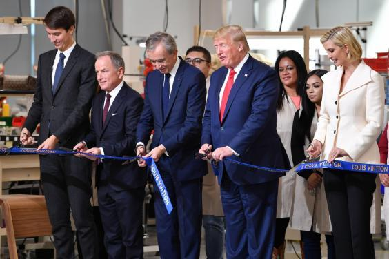 Donald Trump attended the opening of a new Louis Vuitton factory alongside Chief Executive of LVMH Bernard Arnault, CEO of Louis Vuitton Michael Burke and Alexandre Arnault, and Ivanka Trump (Getty)