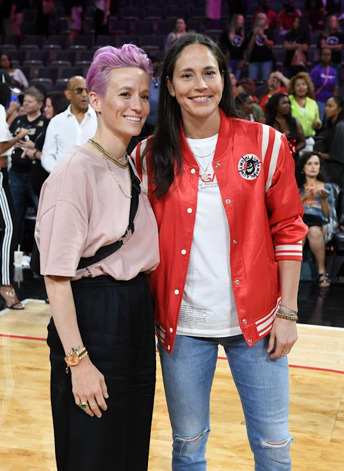 Megan Rapinoe, left, and Sue Bird are among the hundreds of athletes who signed on to an amicus brief calling on the Supreme Court to reject a Mississippi abortion law.