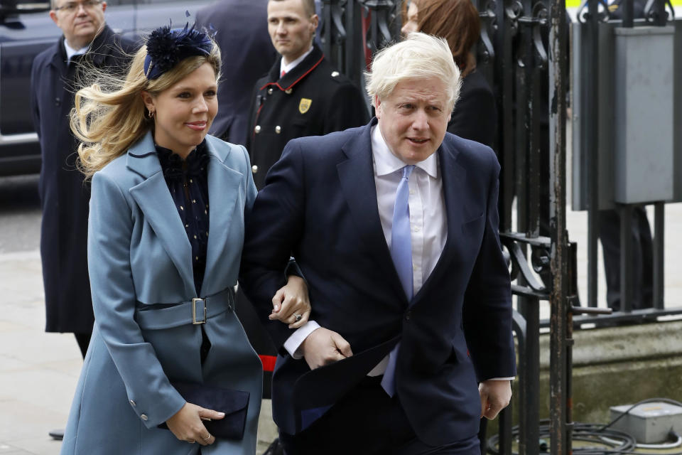 FILE - In this Monday, March 9, 2020, file photo Britain's Prime Minister Boris Johnson and his partner Carrie Symonds arrive to attend the annual Commonwealth Day service at Westminster Abbey in London. U.K. newspapers are reporting that Prime Minister Johnson and his fiancée Symonds married Saturday, May 29, 2021, in a small private ceremony in London. The Mail on Sunday and the Sun said the couple wed at the Roman Catholic Westminster Cathedral in front of a small group of friends and family. (AP Photo/Kirsty Wigglesworth, File)
