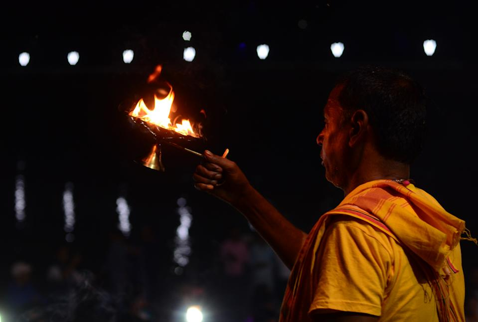 An Indian hindu priest offer evening prayers on the banks of Yamuna river after Supreme Court's verdict on a disputed religious site, in Ayodhya, India, November 9, 2019. Hindus will get the entire disputed 2.77 acres in Ayodhya, SC has ruled 9 years after the Allahabad HC ruling. Muslims will get alternative land either in the surplus 67 acres acquired by central govt around the disputed structure or at another prominent place. (Photo by Ritesh Shukla/NurPhoto via Getty Images)