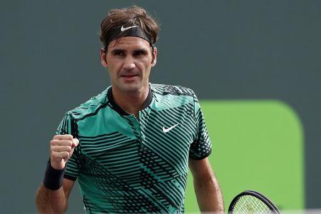 Mar 25, 2017; Miami, FL, USA; Roger Federer of Switzerland celebrates after winning match point against Frances Tiafoe of the United States (not pictured) on day five of the 2017 Miami Open at Crandon Park Tennis Center. Mandatory Credit: Geoff Burke-USA TODAY Sports