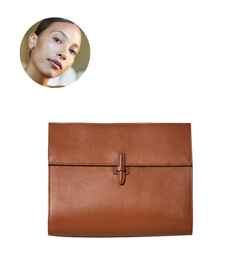 "Between work and family trips, influencer <a href=""https://www.instagram.com/tylynnnguyen/"" rel=""nofollow"">TyLynn Nguyen</a> is always on the go. After a quick scroll through her beautifully curated Instagram, you'll see it's no surprise her pick is this elegant pouch from Hunting Season that fits all her travel necessities perfectly. Bonus, it doubles as a clutch to save space in her suitcase. $595, Hunting Season The Soft Clutch. <a href=""https://www.hunting-season.com/products/the-soft-clutch-in-napa-leather?variant=27684630495306"">Get it now!</a>"