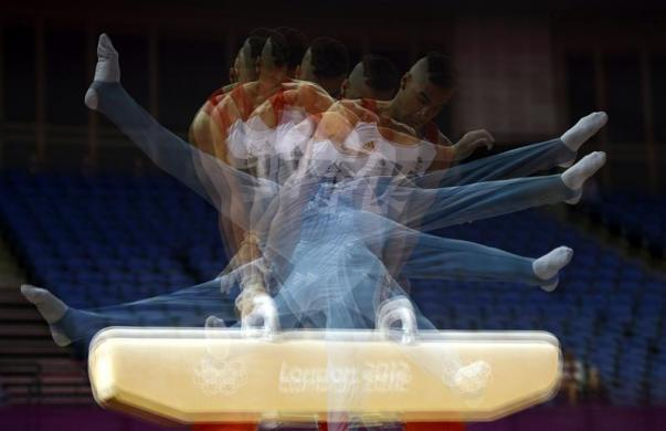 Louis Smith of Britain practices on the pommel horse during a training session at the O2 Arena before the start of the London 2012 Olympic Games in London July 25, 2012.
