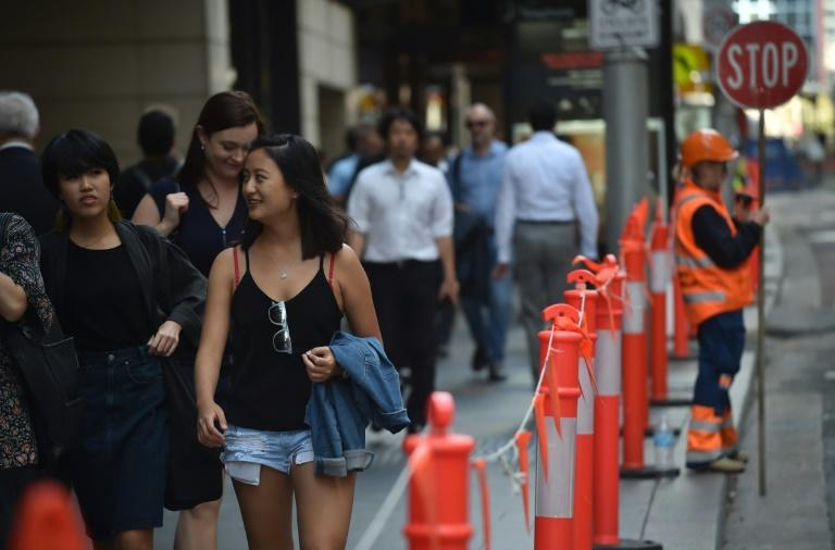 Pedestrians in Sydney's central business district on April 19, 2017. Australia's  decision to scrap a visa programme for temporary foreign workers won both praise and criticism
