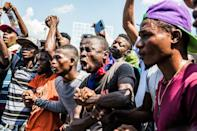 Opponents of President Jovenel Moise have protested and set up barricades around the country, frustrating the distribution of food (AFP Photo/Valerie Baeriswyl)