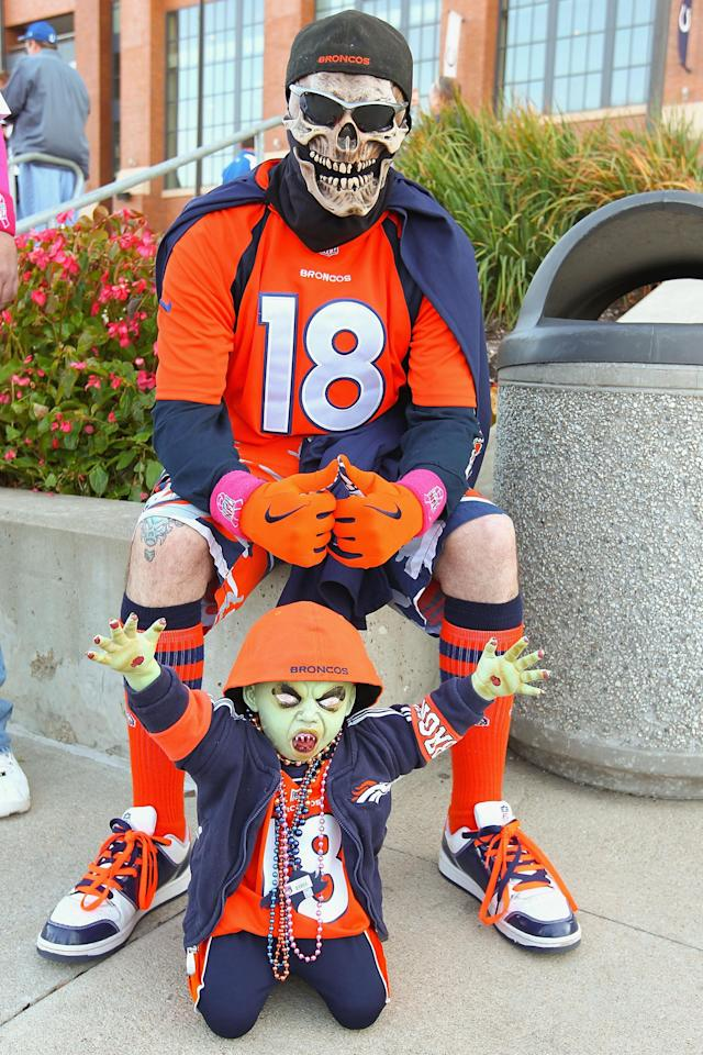 INDIANAPOLIS, IN - OCTOBER 20: A Peyton Manning fan poses for a photograph outside Lucas Oil Stadium prior to a game between the Indianapolis Colts and the Denver Broncos on October 20, 2013 in Indianapolis, Indiana. (Photo by Dilip Vishwanat/Getty Images)