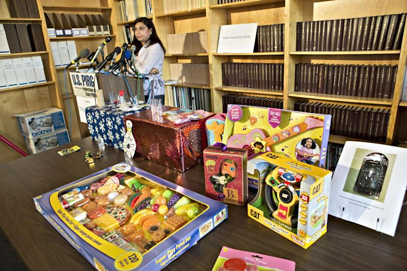 With various toys laid out on a table, Nasima Hossain, a U.S. Public Interest Research Group (PIRG) advocate speaks, during a news conference in Washington, Tuesday, Nov. 20, 2012 where PIRG released its 27th annual Trouble in Toyland report on hazardous toys. (AP Photo/J. Scott Applewhite)