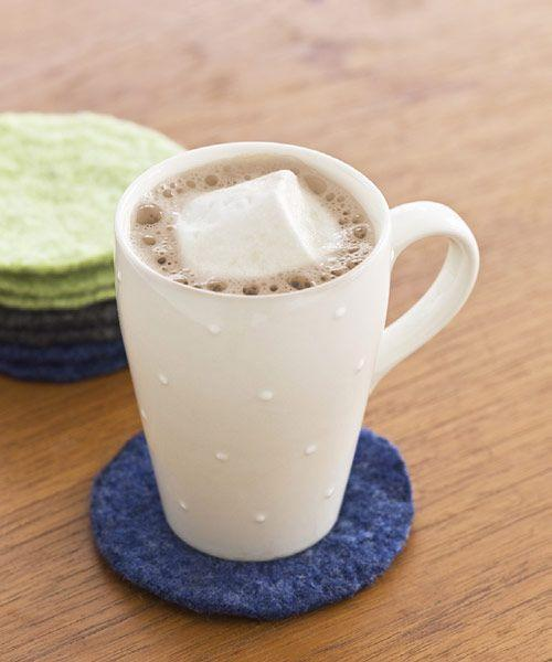 <p>This simple craft turns your tattered cardigans and shrunken pullovers into coasters that you can use time and time again. Wash 100% wool in hot water, then dry with an agitator like jeans. After three rounds, sweaters should feel taut and felt-like. Use a pencil and a large-mouthed glass to trace circles onto the fabric and then snip out a set.<br></p>