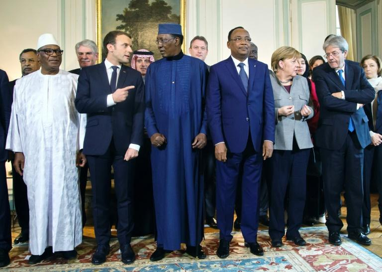 (L-R) Presidents of Mali, Ibrahim Boubacar Keita, France, Emmanuel Macron, Chad, Idriss Deby, Niger, Mahamadou Issoufou, German Chancellor Angela Merkel and Italy PM Paolo Gentiloni at the G5 Sahel anti-terror summit near Paris, on December 13, 2017