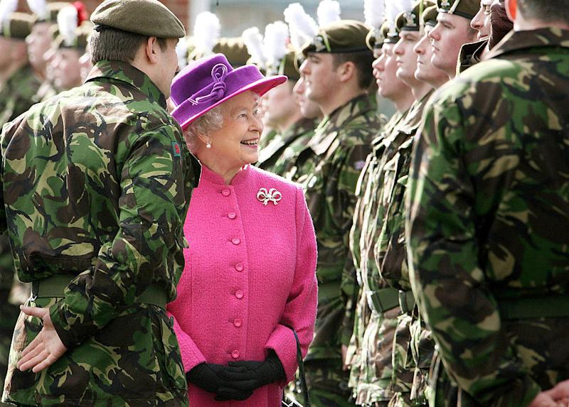 queen smiling with soldiers