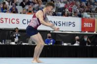 Eddie Penev celebrates after his floor exercise routine during the U.S. Gymnastics Championships, Saturday, June 5, 2021, in Fort Worth, Texas. (AP Photo/Tony Gutierrez)