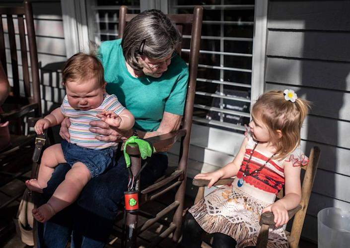 Shirley Hoffmann visits with her great grandchildren, Margot Stocker, left, and Grace Stocker in Charlotte, NC, on Monday, April 5, 2021.