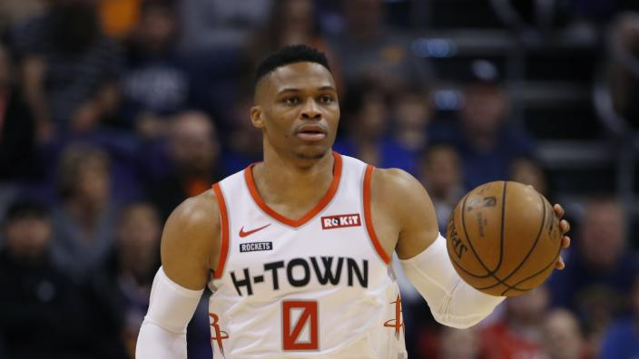 Houston Rockets guard Russell Westbrook dribbles the ball against the Phoenix Suns during the first half of an NBA basketball game Saturday, Dec. 21, 2019, in Phoenix. The Rockets defeated the Suns 139-125. (AP Photo/Ross D. Franklin)