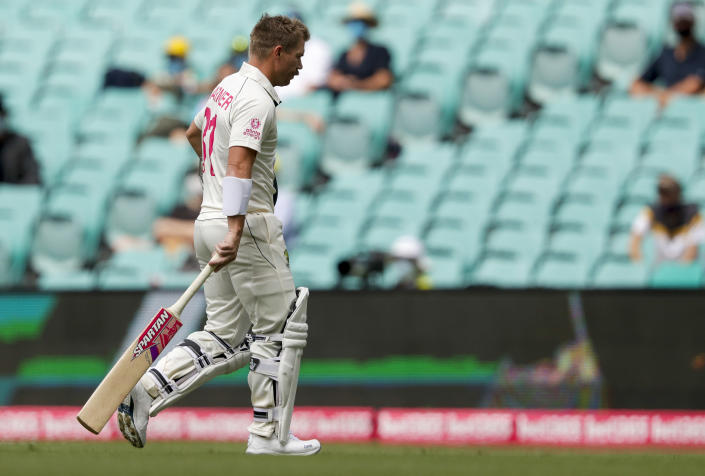 Australia's David Warner walks from the field after he was dismissed for five runs during play on day one of the third cricket test between India and Australia at the Sydney Cricket Ground, Sydney, Australia, Thursday, Jan. 7, 2021. (AP Photo/Rick Rycroft)