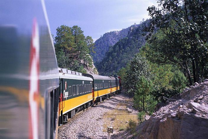 """<p><a href=""""https://www.coppercanyon.com/index.php/train"""" rel=""""nofollow noopener"""" target=""""_blank"""" data-ylk=""""slk:The Copper Canyon Train"""" class=""""link rapid-noclick-resp"""">The Copper Canyon Train</a> was designed to connect the Pacific Ocean with Mexico's central desert territory and has been a popular trip with tourists since its inception. The four-hour route traverses snow-topped mountains and primeval forests as it journeys through Mexico's Cooper Canyon, a site four times bigger than the Grand Canyon, to the coast.</p>"""